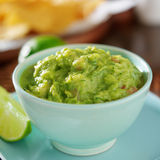 Guacamole in colorful blue bowl Royalty Free Stock Photos