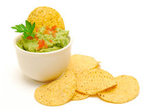 Guacamole and corn chips isolated royalty free stock photo