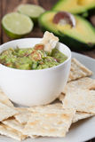 Guacamole with crackers. Bowl with freshly made guacamole and crackers. Shallow dof Royalty Free Stock Image