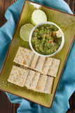 Guacamole with crackers. Bowl with freshly made guacamole and crackers. Shallow dof Stock Photography