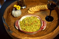 Guacamole dip can be a party for one stock image