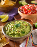 Guacamole Dip. A delicious authentic mexican guacamole dip with avacado, lime, tomato, cilantro, and jalapeno pepper Royalty Free Stock Photos