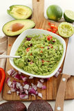 Guacamole dip. Delicious guacamole dip on the table royalty free stock images