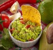 Guacamole dip. Ingredients for avocado guacamole dip and nachos stock photo