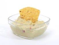 Guacamole dip with nacho royalty free stock image
