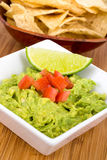 Guacamole dip with nacho. Close up Stock Images