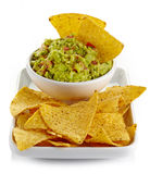 Guacamole dip and nachos Stock Photo