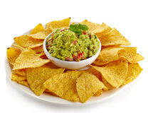 Guacamole dip and nachos Royalty Free Stock Photography