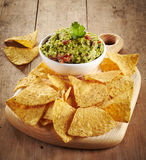 Guacamole dip and nachos Stock Photos