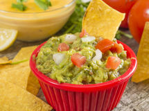 Guacamole. Fresh homemade guacamole with hot cheese dip and tortia chips stock images