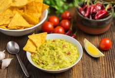 Guacamole in home white on wooden desk. Royalty Free Stock Photo