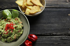 Guacamole and homemade nachos Royalty Free Stock Images