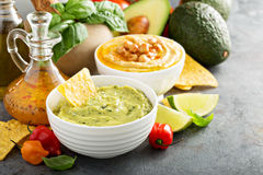 Guacamole and hummus in white bowls Stock Image