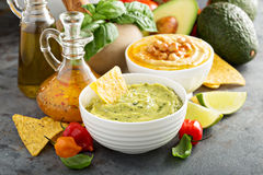 Guacamole and hummus in white bowls Stock Images