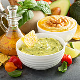 Guacamole and hummus in white bowls Royalty Free Stock Photos