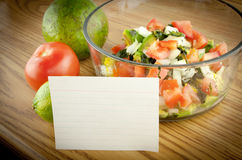 Guacamole Ingredients With Recipe Card. Ingredients in a bowl  with a blank white recipe card Royalty Free Stock Image