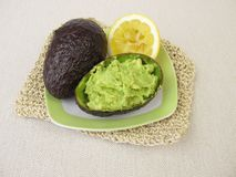 Guacamole with lemon in avocado peel Royalty Free Stock Images