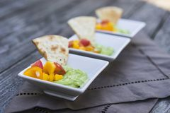 Guacamole and mango salsa Royalty Free Stock Photos