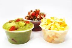 Guacamole met tomaat, Mexicaanse voedselkanten Royalty-vrije Stock Afbeeldingen