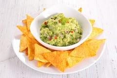 Guacamole and nacho. Close up on guacamole and nacho Stock Photos