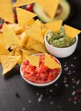 Guacamole with nachos in freeze motion Royalty Free Stock Photography