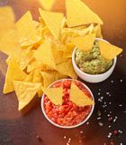 Guacamole with nachos in freeze motion Royalty Free Stock Image