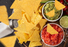 Guacamole with nachos in freeze motion Royalty Free Stock Images