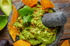 Guacamole with nachos in Mexican molcajete Stock Photos