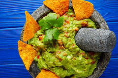 Guacamole with nachos in Mexican molcajete Royalty Free Stock Photo