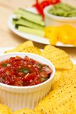 Guacamole and salsa dips. A starter of guacamole, salsa and different dips carrot, pepper and cucumber n stock images