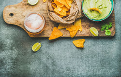 Guacamole sauce, corn chips, beer in glass, copy space Royalty Free Stock Photos