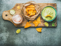 Guacamole sauce, corn chips, beer in glass, top view Royalty Free Stock Photos