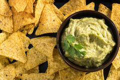Guacamole sauce with corn chips Stock Photos