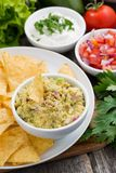 Guacamole sauce and corn chips, vertical Royalty Free Stock Image