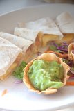 Quesadillas with guacamole sauce. Guacamole sauce with quesadillas at lunch time in Mexico Royalty Free Stock Images