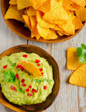 Guacamole sauce on  wooden table. Royalty Free Stock Photography