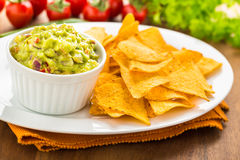 Guacamole with tortilla chips Stock Photography