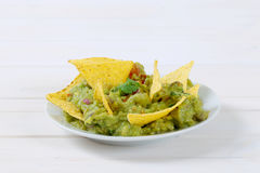 Guacamole with tortilla chips Stock Images