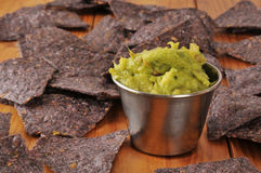 Guacamole and tortilla chips Stock Photo