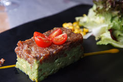 Guacamole and tuna starter Stock Photos