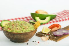 Guacamole with vegetables and snacks in a wooden bowl, vegan snack, vegetarian concept dinner. N Royalty Free Stock Photo