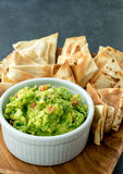 Guacamole vertical view. Guacamole is a avocado based dip, traditionally a mexican Aztecs dish. Healthy and easy to make at home with a few simple ingredients royalty free stock photo