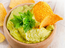 Guacamole. On wooden table. Selective focus stock images
