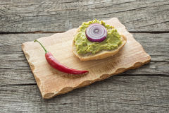 Guacomole with onions on a roll Stock Photo