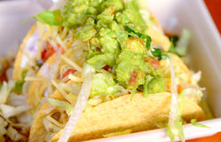 Guacomole and taco shells. Fresh avocado Mexican guacamole with salad,taco shells, chips Stock Images