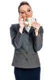 Guadagni dei soldi della giovane donna Fotografia Stock