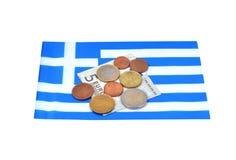 Guadagni nel concetto della Grecia con soldi e la bandiera Fotografia Stock