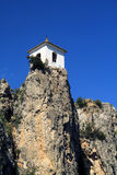 Guadalest Bell tower on the cliff Royalty Free Stock Photography
