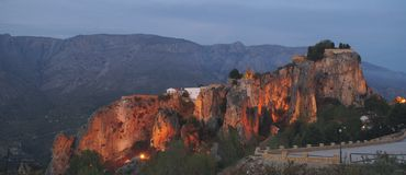 Guadalest at Dusk. A view of Guadalest Fortress at nightfall with a mountain backdrop Royalty Free Stock Photo