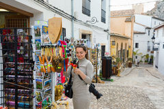 Guadalest gift stall editorial. GUADALEST, SPAIN – MAY 05, 2016: woman on summer holiday shopping in gift street stall store Stock Images